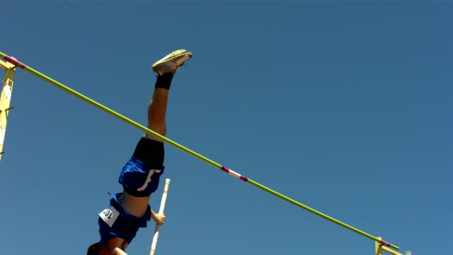 Track and Field athlete doing pole vault, slow motion video