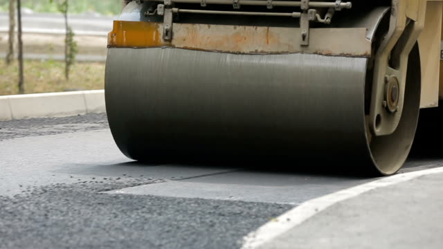Tracked Pavers Laying Asphalt video