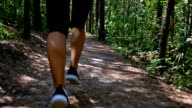 istock Tracking camera of woman girl running jogging in park, wood, forest, slow motion 627998270