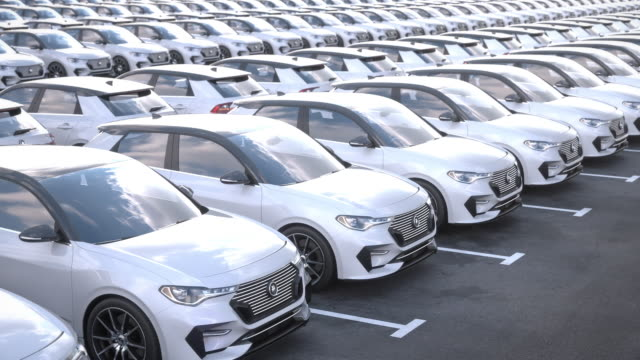 Tracking shot along new electric self driving cars on big storage parking lot Tracking shot along rows of new electric self driving cars on car on big storage parking lot. New electric cars for sale at car dealership parking lot. Realistic high quality 3d animation. car dealership stock videos & royalty-free footage