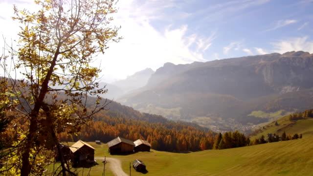 tracking shot barns in autumn Alta Badia, Dolomites tracking shot barns in autumn Alta Badia, Dolomites housing logo stock videos & royalty-free footage