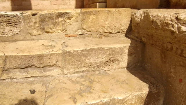 tracking shot from marble stairs to columns, Assisi video