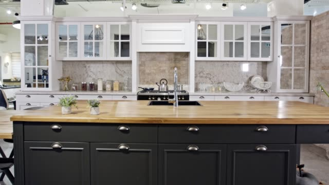 tracking shot of a large luxury kitchen with grey and white classic design - kitchen room video stock e b–roll