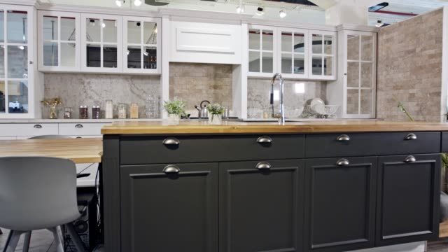 Tracking shot of a large luxury kitchen with grey and white classic design