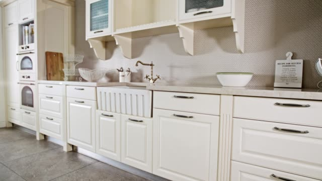 Tracking shot of a large luxury kitchen with white classic design