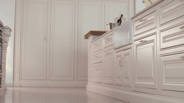 Tracking shot of a luxury kitchen Tracking shot of a large luxury kitchen cabinet stock videos & royalty-free footage