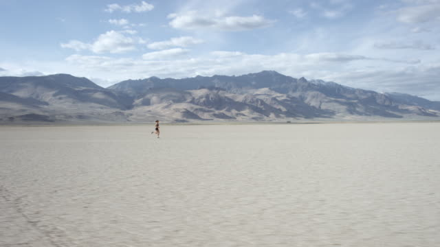 Tracking Shot of a Woman Running in the Desert video