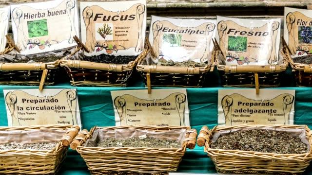 Tracking shot of herbs/tea for sale in Granada, Spain video
