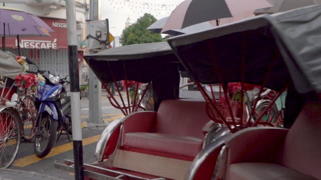 Tracking shot of Parked trishaws in Penang