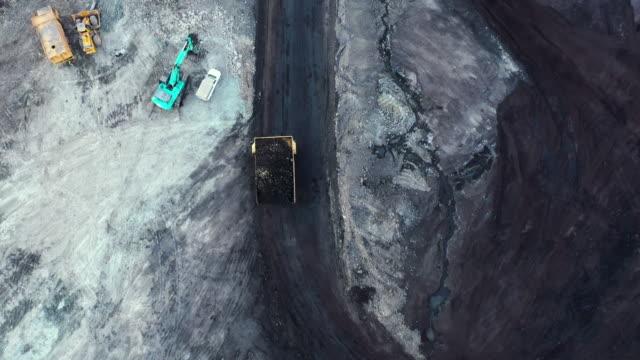 Tracking shot of truck working in coal mine