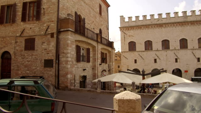 tracking shot on medieval palaces in downtown alleys, Assisi video