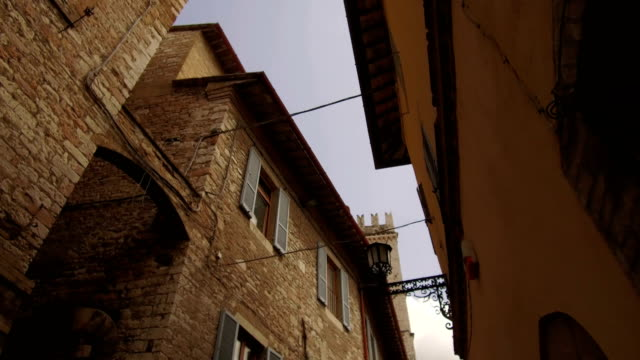tracking shot on roofs in downtown alleys, Assisi video