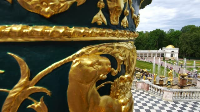 Tracking shot showing Grand Palace Cascade and Samson fountain in Peterhof, Saint Petersburg, Russia