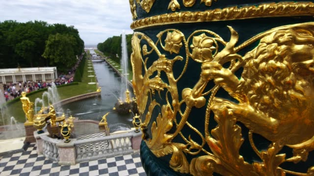 Tracking shot showing Grand Palace fountains and sculptures park in Peterhof, Saint Petersburg, Russia
