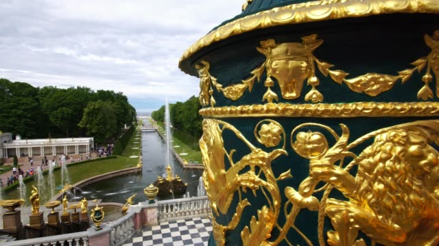 Tracking shot showing Grand Palace fountains park in Peterhof, Saint Petersburg, Russia