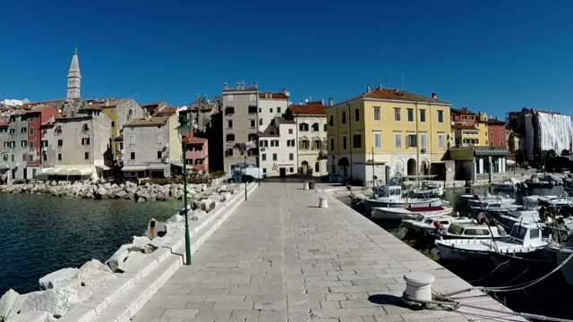Tracking view of old town on harbour in Rovinj. video