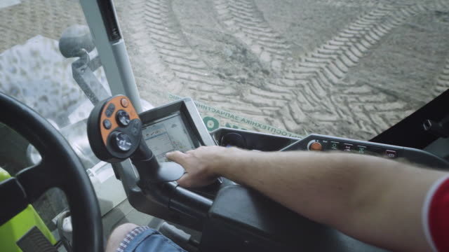 Tractor driver point of view. Tractor driving control panel video