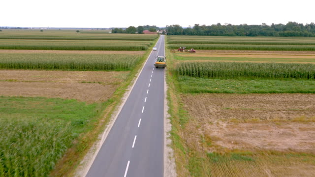 AERIAL Tractor driving along country road video