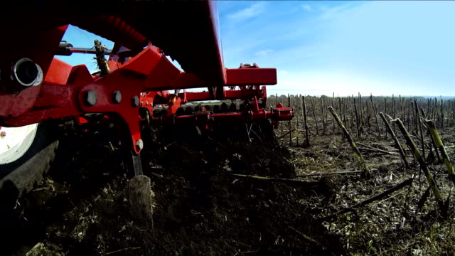 Tractor handles field. Disking. Processing field tractor. Tractor disc ground. Rural locality. The land is ready for planting grass. harrow agricultural equipment stock videos & royalty-free footage