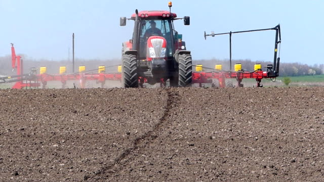 Tractor planting seeds video
