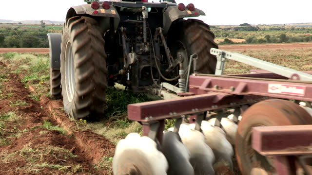 Tractor ploughing farm fields, South Africa video