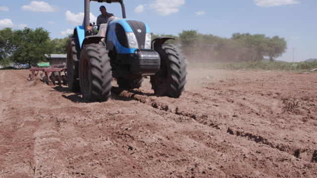 Tractor ploughing farm fields video