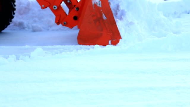 Tractor Plowing Snow Man plowing snow with tractor. plow stock videos & royalty-free footage