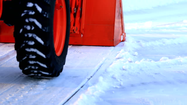 Tractor Plowing Snow Man plowing snow with tractor. plowing stock videos & royalty-free footage