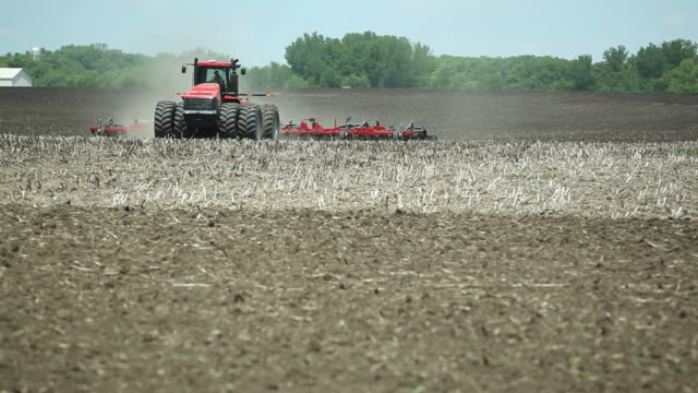 Tractor Plowing Spring Farm Field