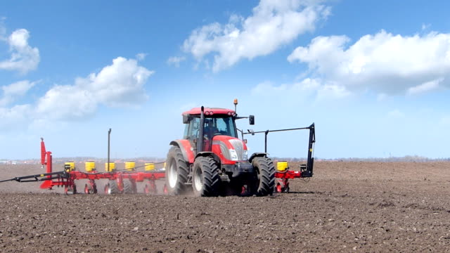 Tractor seeding on a field video