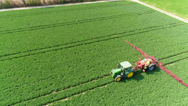 Tractor Spraying Crop Field In Spring video