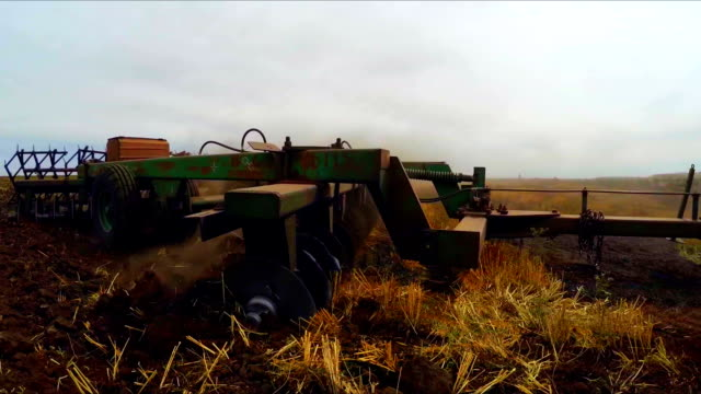 Tractor Trailer Plowing Agricultural Field video