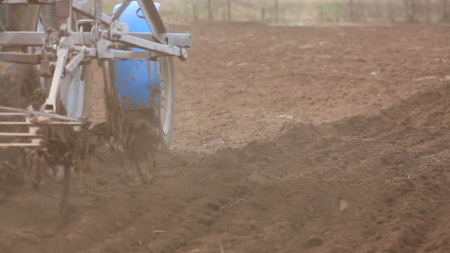 Tractor Working On Farmland