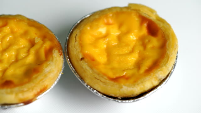 Traditional asian dessert egg tarts sweet custard pie video