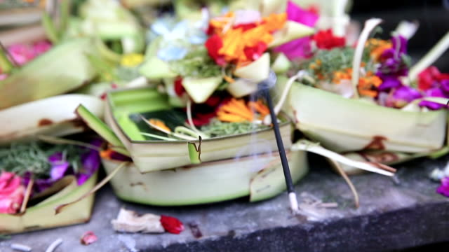 Traditional Balinese Offerings To Gods In Bali With Flowers, Bali