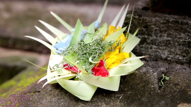 Traditional Balinese Offerings To Gods In Bali With Flowers