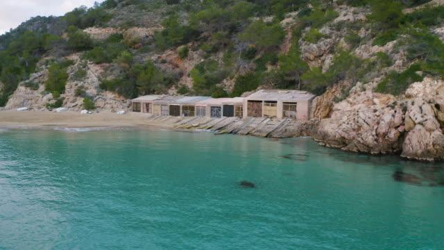 vídeos de stock e filmes b-roll de traditional boat shelter in ibiza. 4k - ibiza