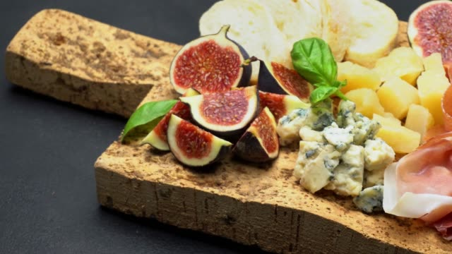 traditional cheese and meat plate wth parma, parmesan and figs video