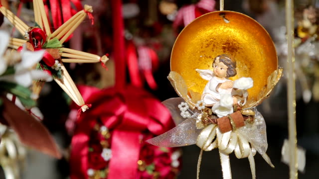 Traditional christmas ornaments on a street in an european city. Outdoors Traditional christmas ornaments on a street in an european city. Outdoors christmas ornament stock videos & royalty-free footage