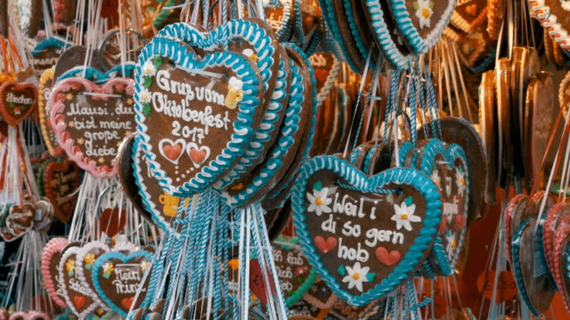Traditional Colorful Gingerbread Heart Shaped at the Oktoberfest Festival, Bavaria, Germany video