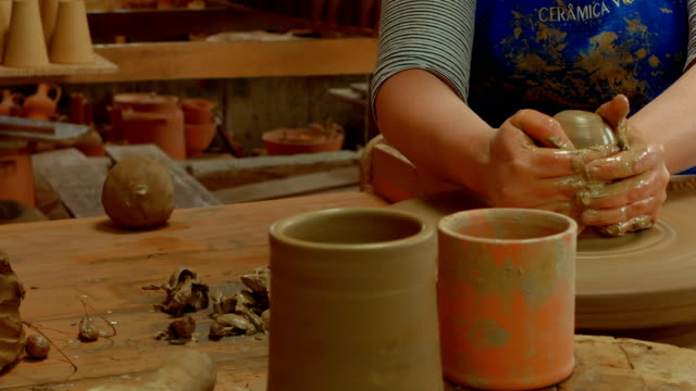 Traditional crafts Traditional crafts - A skilled potter throwing clay into a wheel and molding different shapes. The archipelago of the Azores is one of the hidden gem holiday destinations in Europe. art and craft product stock videos & royalty-free footage