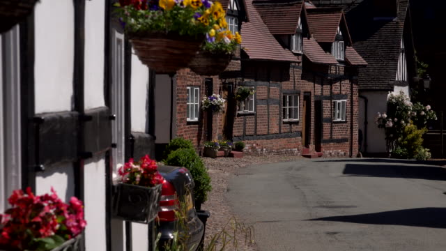 Traditional English village in the UK 4K England rural buildings and village charming stock videos & royalty-free footage