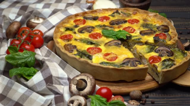 traditional french baked homemade quiche pie on wooden board - cucina francese video stock e b–roll