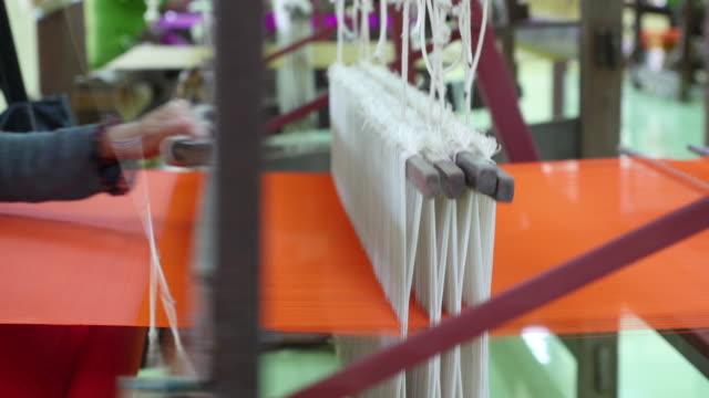 traditional hand-weaving loom video