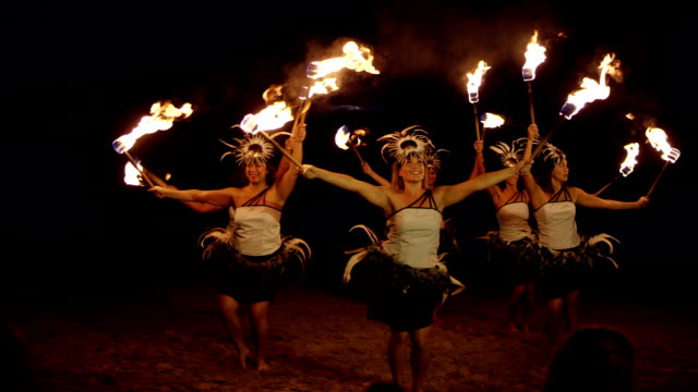 Traditional Hawaiian Fire Hula Dancers A Hawaiian fire hula dance show on the beach in Hawaii. hawaii islands stock videos & royalty-free footage