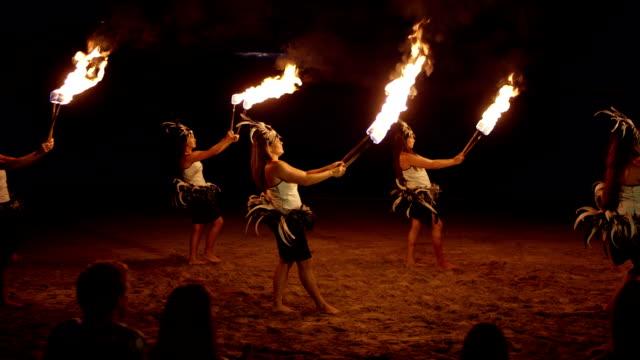 Traditional Hawaiian Fire Hula Dancers A Hawaiian fire hula dance show on the beach in Hawaii. big island hawaii islands stock videos & royalty-free footage
