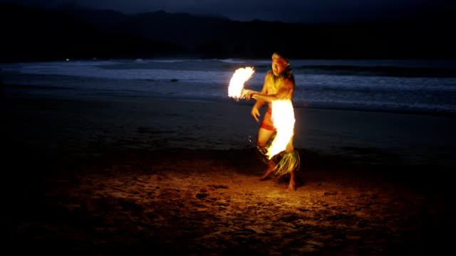 Traditional Hawaiian Fire Knife Dancer A Hawaiian fire knife dance show on the beach in Hawaii. big island hawaii islands stock videos & royalty-free footage