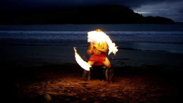 Traditional Hawaiian Fire Knife Hula Dancer A Hawaiian fire hula dance show on the beach in Hawaii. pacific islands stock videos & royalty-free footage