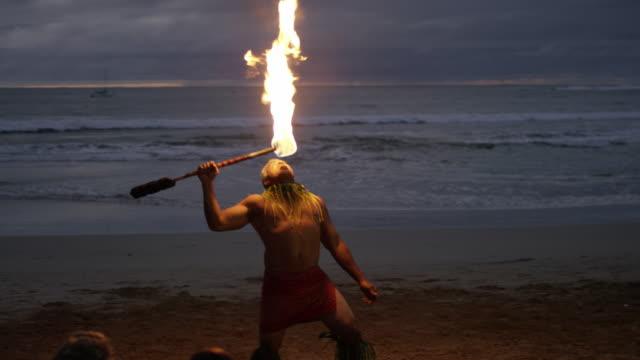 Traditional Hawaiian Fire Knife Hula Dancer A Hawaiian fire hula dance show on the beach in Hawaii. big island hawaii islands stock videos & royalty-free footage