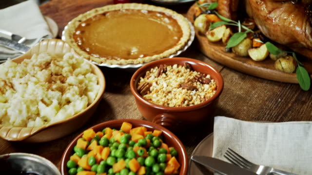 Traditional Holiday Stuffed Turkey Dinner Family having traditional holiday dinner with stuffed turkey, mashed potatoes, cranberry sauce, vegetables pumpkin and pecan pie. thanksgiving stock videos & royalty-free footage